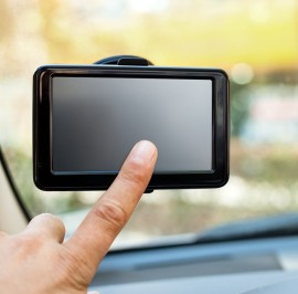 bigstock-finger-pointing-at-car-GPS-nav-37304524