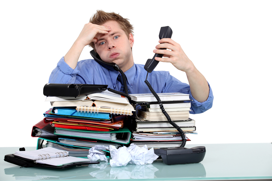Overworked Worker or Employee with a Full Inbox - Royalty Free Clip Art  Picture