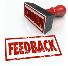 A red rubber stamp with the word Feedback to illustrate comments