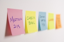 Sticky notes of to do list on wall.