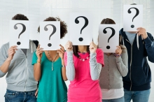 Students Hiding There Face With Question Mark Sign, uncertainty