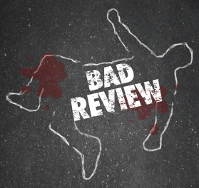 Bad Review words on a chalk outline for a dead body of a person