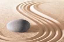 zen stone garden round stone and raked sand making line patterns