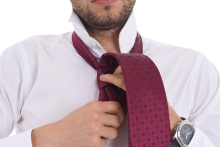 Young Man Tying A Necktie