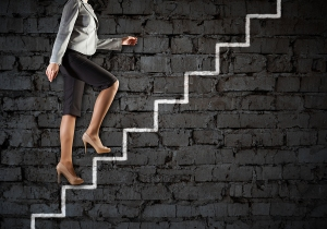 Image of businesswoman climbing career ladder. Success and achie