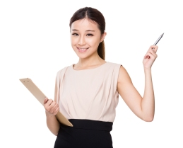 Asian woman holding with clipboard and pen point up
