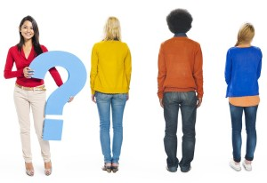 People Facing Backwards with Woman Holding Question Mark