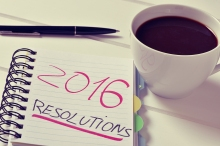 closeup of a notebook with the text 2016 resolutions written in
