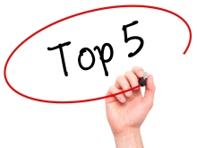 Man Hand writing Top 5 with black marker on visual screen. Isola