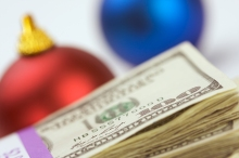 Money and Christmas Ornaments with Narrow Depth of Field.