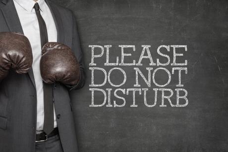 Please do not disturb on blackboard with businessman on side