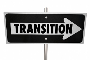Transition word on a road sign to illustrate change, improvement