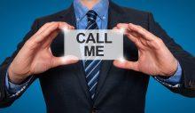 Call me. Businessman shows business card