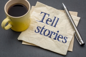 Tell stories advice or reminder - handwriting on a napkin with c