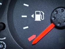 Car Fuel Gauge Showing Empty, Close Up