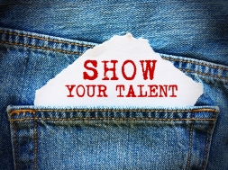 SHOW YOUR TALENT on white paper in the pocket of blue denim jeans