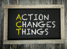 Action Changes Things written on chalkboard
